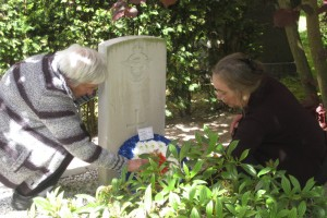 Gerald Hood's neices; Mrs Sally Brown and Mrs Mary Williams lay their wreath on their Uncle's grave