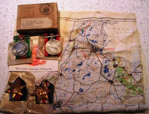 John Downie's silk escape map of the Netherlands and his medal collection; 1939-45 Star, France and Germany Star, WWII Medal and Defence Medal. (Courtesy of mr Richard Jones)