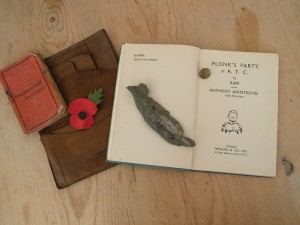 Laurence Watts' wallet, a uniform button, the two books sent to him by his sister for his 23rd birthday and the shard of molten alloy from LM658